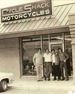 Richard Sanders, Don Schultz, Lyle Lovett, and Robert Tuggle at the Cycle Shack in Bellaire, Texas.