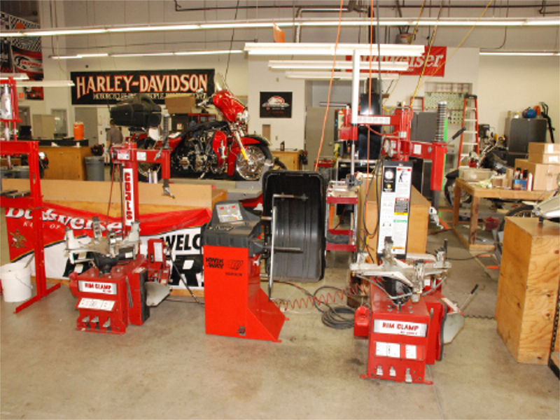 Service Department work area full of red machines.