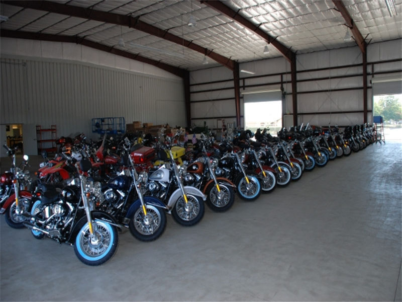 A row of motorcycles in a garage.
